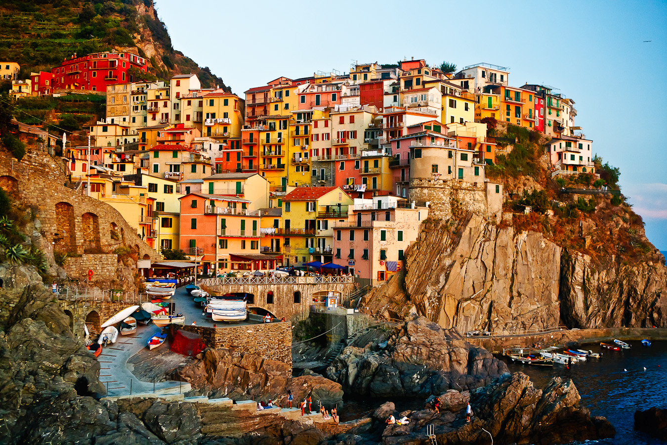 """This image is a different composition than the earlier production of a similar image titled """"Golden Hour at Manarola"""". The frame is almost the same but the photo was taken later in the day and post processed to create a somewhat somber mood to characterize the retreat from the sea. Posterization was added to create a painterly look consistent with other Cinque Terre images intended to compose a related collection of fine art prints. Processed by Sam Dobrow 11-26-2011"""